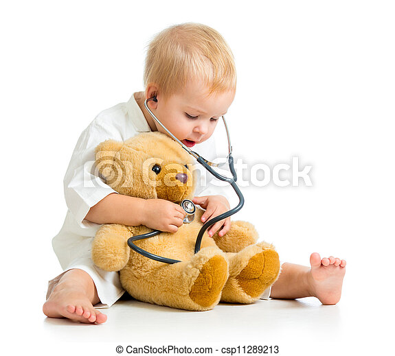 Adorable child with clothes of doctor and teddy bear over white - csp11289213