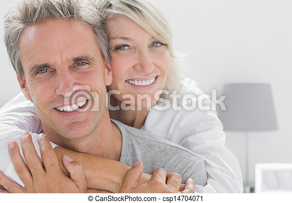 Affectionate couple smiling at camera - csp14704071
