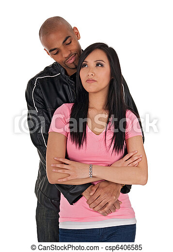 Affectionate guy embracing sceptical-looking woman - csp6406585