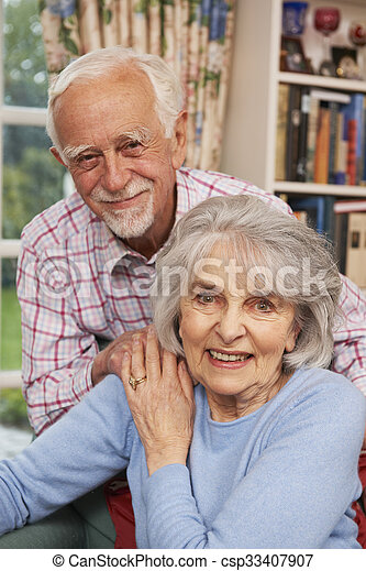 Affectionate Senior Couple At Home Together - csp33407907