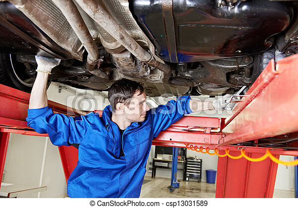 auto mechanic at wheel alignment work with spanner - csp13031589