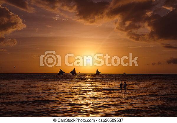 Beautiful sunset and sailboats - csp26589537