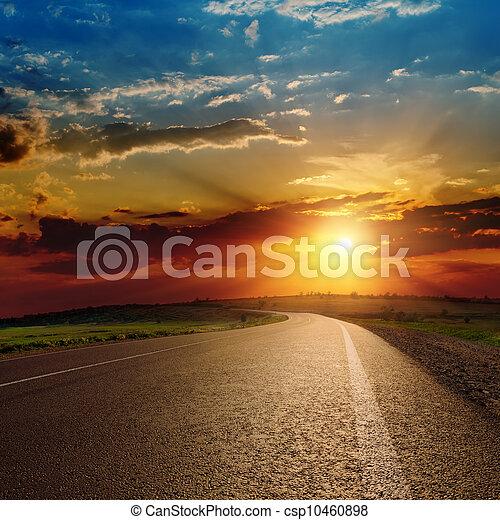 beautiful sunset over asphalt road - csp10460898
