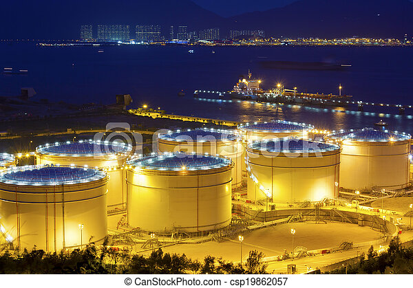 Big Industrial oil tanks in a refinery at night - csp19862057