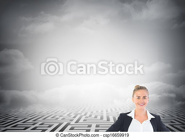 Blonde businesswoman standing with hands on hips - csp16659919
