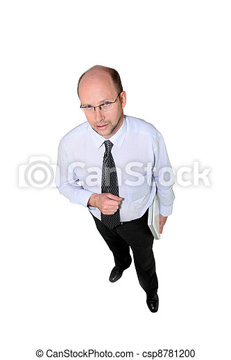 Business owner standing on white background - csp8781200