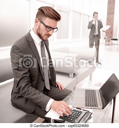 businessman analyzing the results of the financial transaction. - csp65324669