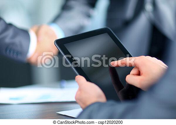 Businessman holding digital tablet - csp12020200