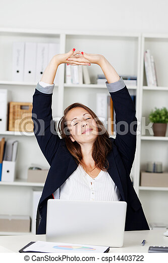 Businesswoman stretching her arms - csp14403722
