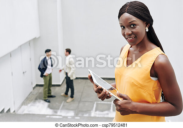 Businesswoman with digital tablet - csp79512481