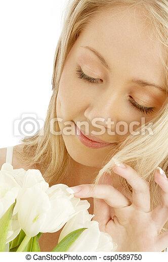 cheerful blond with white tulips - csp0589750