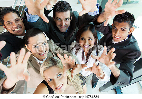 cheerful group of business people reach out - csp14781884