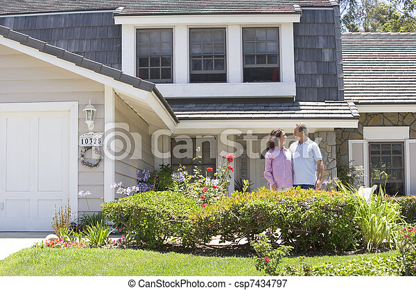 Couple Standing Outside Their House - csp7434797