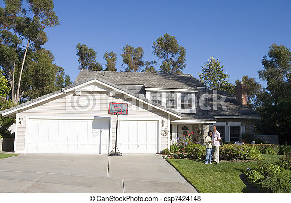Couple Standing Outside Their House - csp7424148