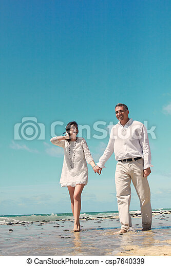 couple walking and laughing - csp7640339