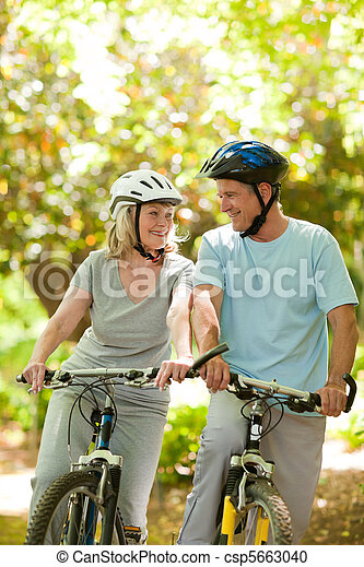 Couple with their bikes in the wood - csp5663040