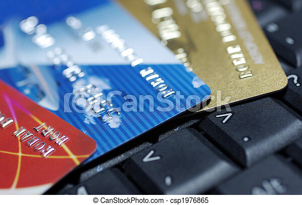 Credit cards laying on laptop keyboard close up photography. - csp1976865