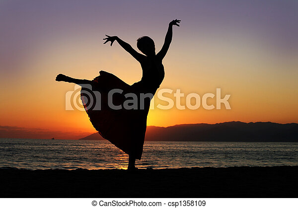 Dancing woman at sunset - csp1358109