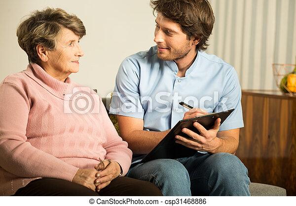 Doctor working in nursing home - csp31468886