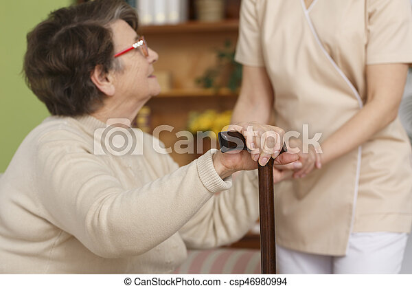 Elderly woman trying to stand up - csp46980994