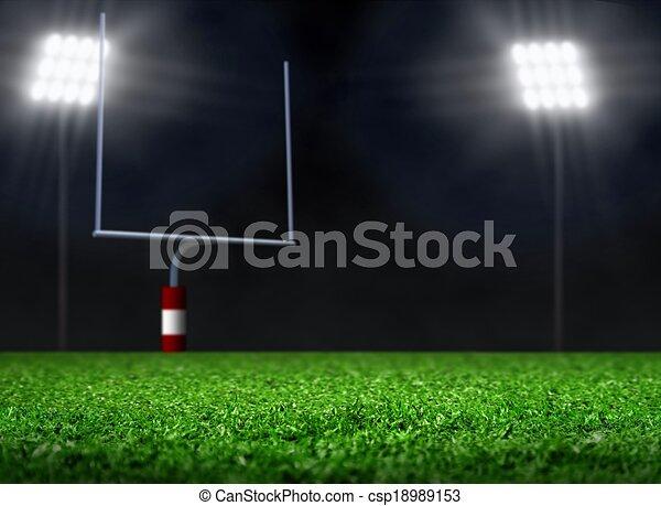 Empty Football Field with Spotlight - csp18989153