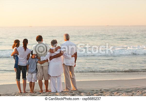 family at the beach - csp5685237