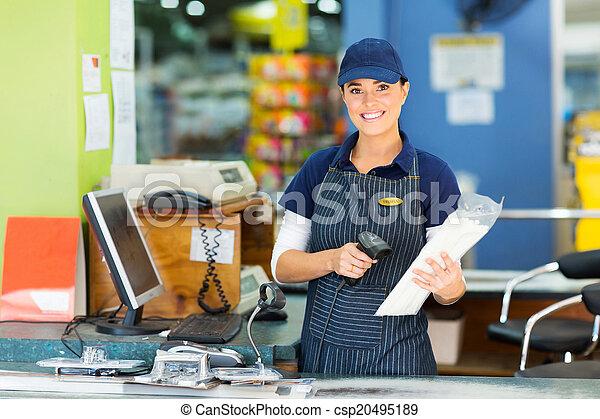 female cashier at hardware store - csp20495189