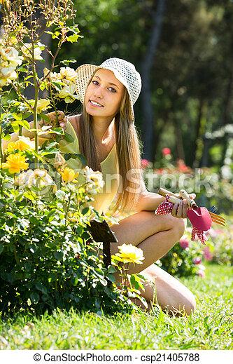 Female gardene near bush - csp21405788