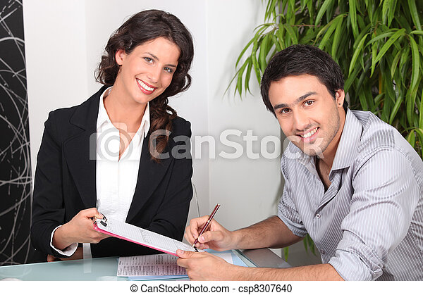 female real estate agent and young man buying house - csp8307640