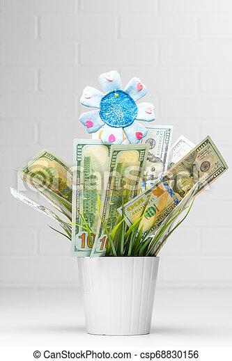 Financial growth. Money Growing in Flower Pot - csp68830156