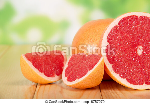 Grapefruit segments on a wooden table - csp16757270