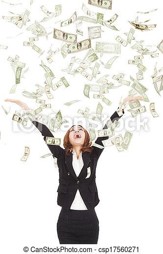 happy businesswoman try to catch the money - csp17560271