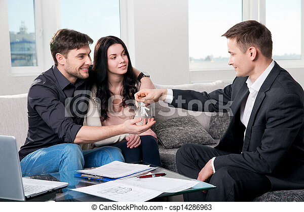 Happy couple with real estate agent - csp14286963