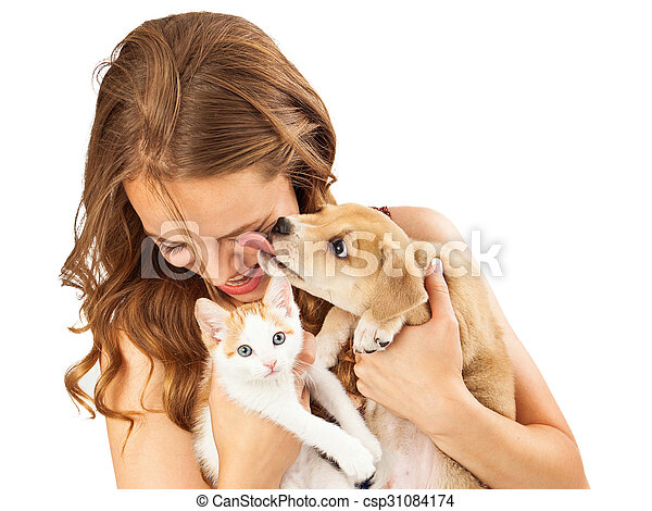 Happy Girl With Kitten and Affectionate Puppy - csp31084174