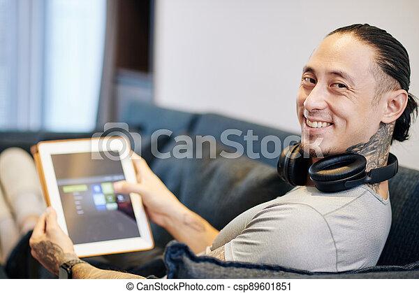 Happy man with digital tablet - csp89601851