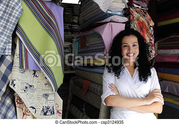 happy owner of a fabric store - csp3124935
