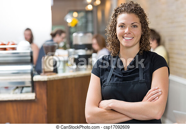 Happy Owner Standing Arms Crossed In cafe - csp17092609