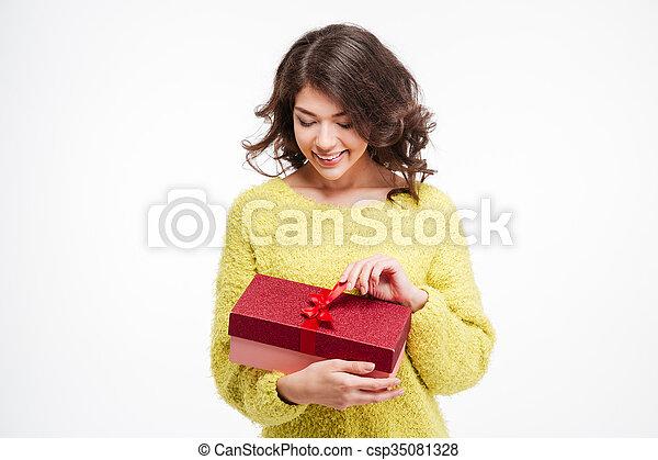 Happy woman holding present box - csp35081328
