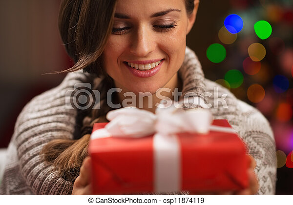 Happy young woman holding Christmas present box - csp11874119