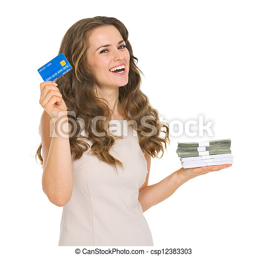 Happy young woman holding credit card and money packs - csp12383303