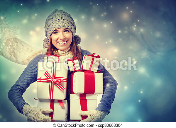 Happy young woman holding many present boxes - csp30683384