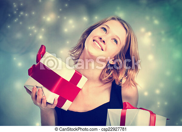 Happy young woman holding present boxes - csp22927781