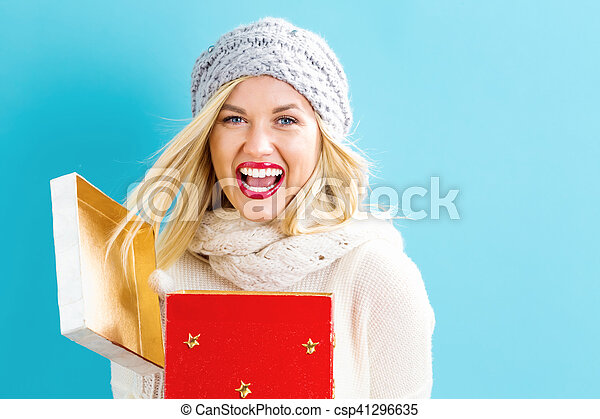 Happy young woman with Christmas present box - csp41296635