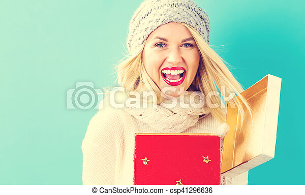 Happy young woman with Christmas present box - csp41296636
