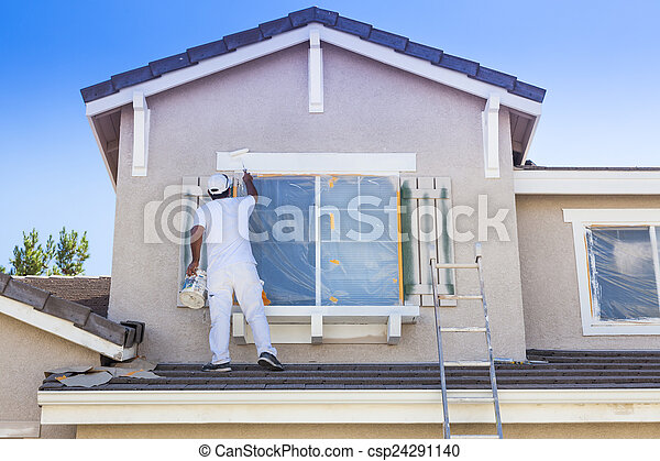 House Painter Painting the Trim And Shutters of Home - csp24291140