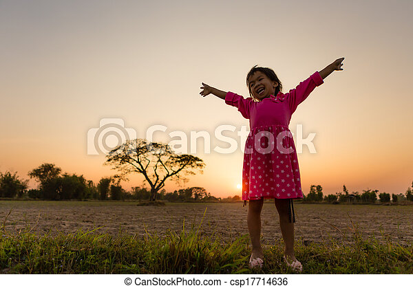 Little girl with sunset - csp17714636