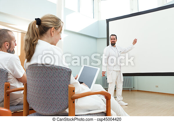 male doctor is doing a lecture - csp45004420