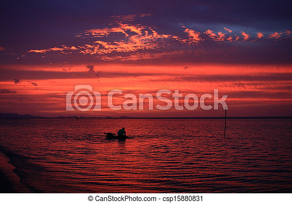 Man bathing buffalo in sunset sea at Samui island, Thailand - csp15880831