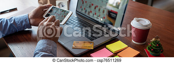 Man paying with credit card and entering security code for online shopping making a payment or purchasing goods on the internet with laptop computer, online shopping concept - csp76511269