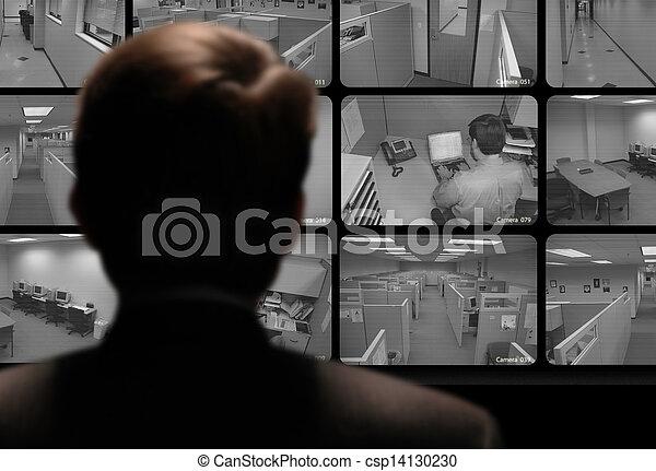 Man watching an employee work via a closed-circuit video monitor - csp14130230